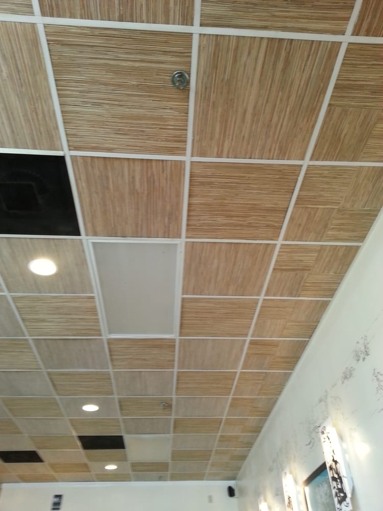 Drop ceiling with what looks like covered in bamboo wall paper