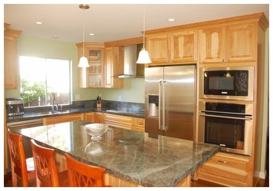 O Kitchen City Of Dreams Of Kitchen Cabinetry With Raised Pecan Wood Panel Doors In