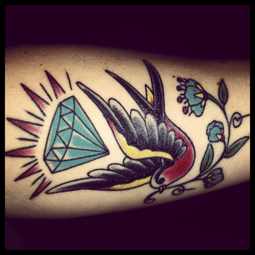Sparrow with diamond and traditional flower done by ben for Outer limits tattoo long beach