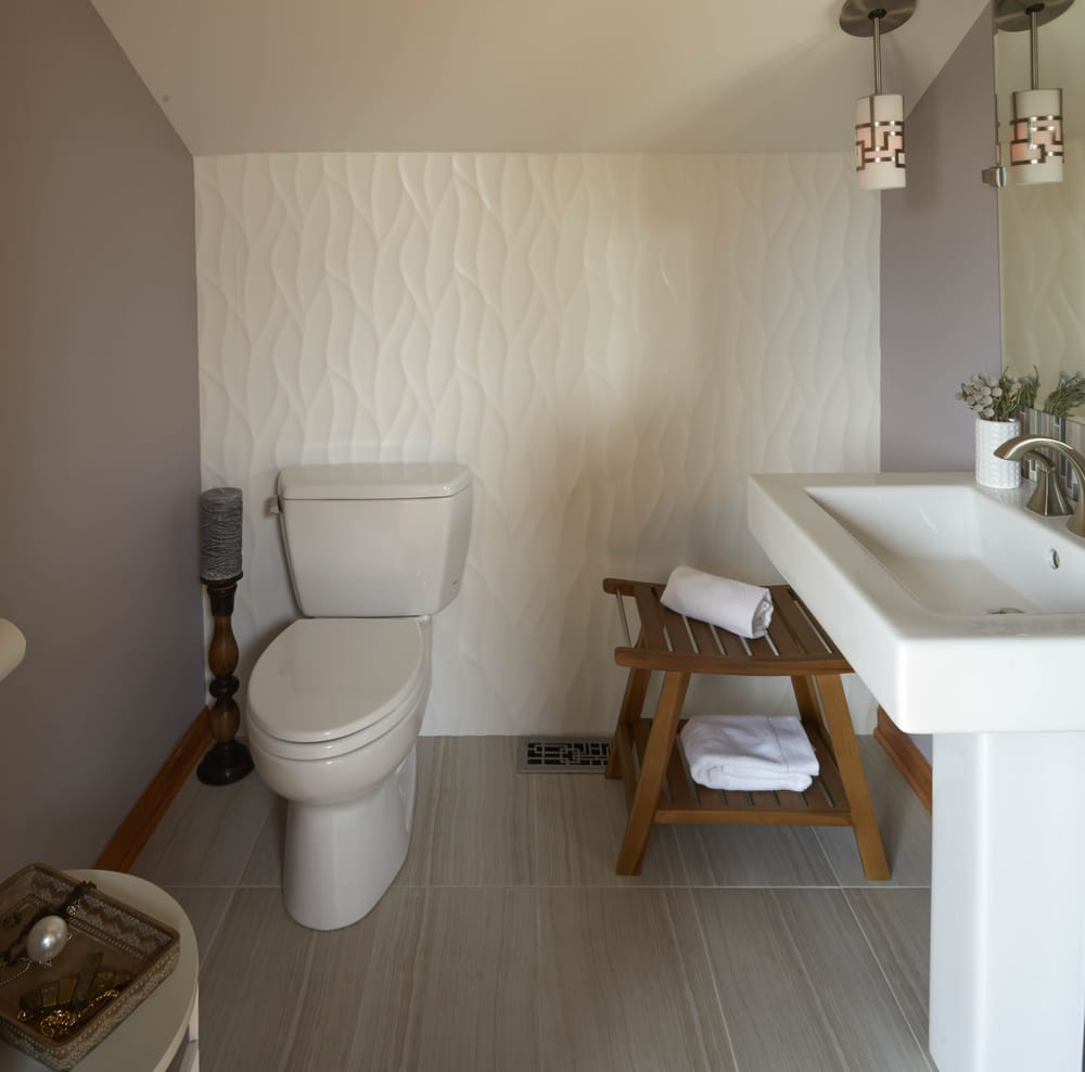Powder Room with organic large format porcelain tile as focal point ...