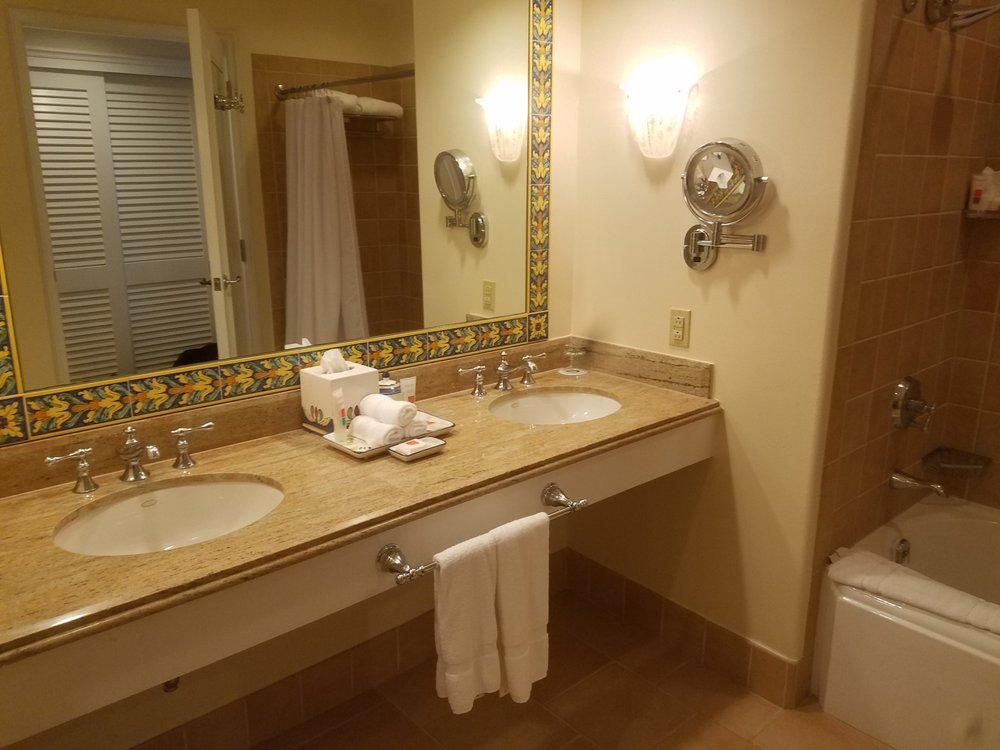 The bathroom is very spacious, though the shower requires you to ...