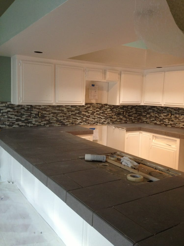 12x24 Porcelain countertops w/Glass mosaic backsplash - Yelp
