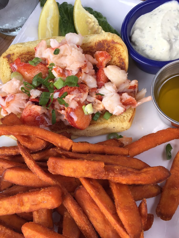 Amazing warm lobster roll with sweet potato fries yelp for Fish tales cape coral