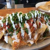 ... Chicken tinga nachos: added refried black beans, ciltantro, corn, pico