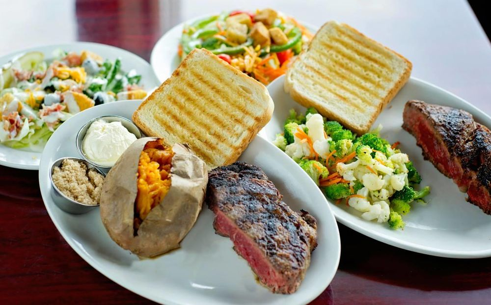 Ribeyes Steakhouse: 104 Golfin Dolphin Dr, Cape Carteret, NC