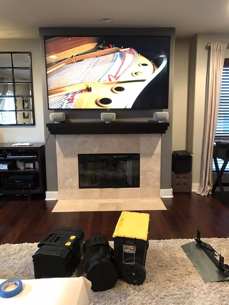 beautiful sony 75 inch 4k tv wall mounted and installed above a fireplace with all wires. Black Bedroom Furniture Sets. Home Design Ideas