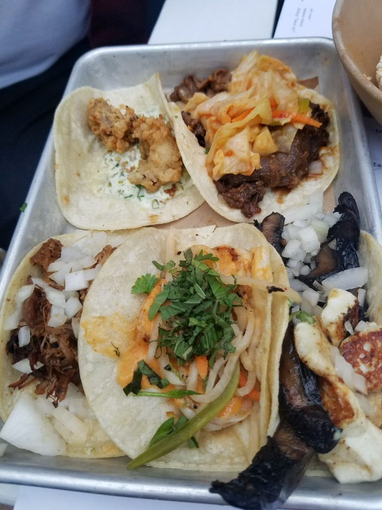 Oyster taco (yum), duck taco with onions (also yum ...
