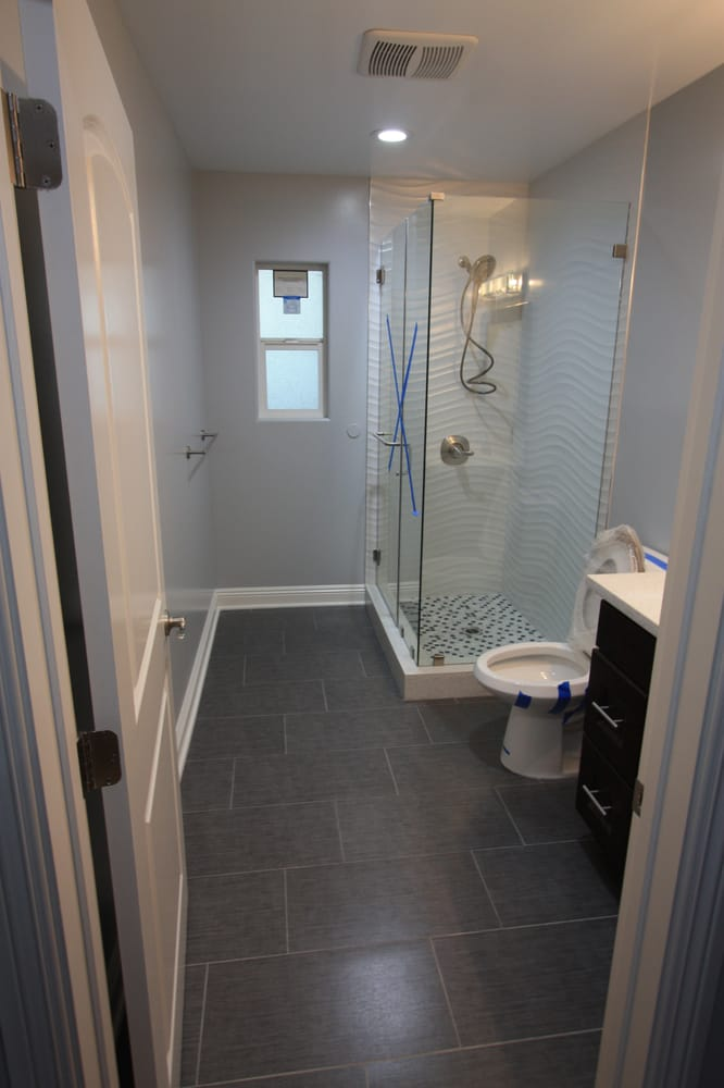 Tile Depot - Bathroom Floor using 12x24 Porcelain Tile - Yelp