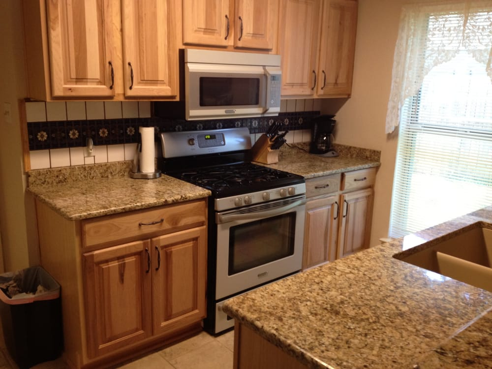 New venetian gold granite countertop yelp for Austin kitchen cabinets