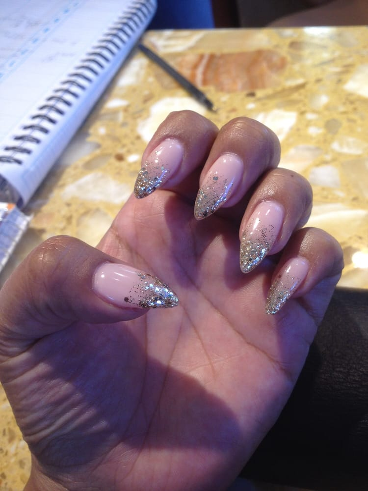 Stiletto nails with #15 gel and gold glitter tips - Yelp