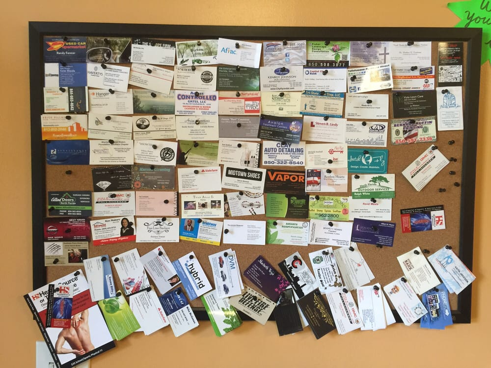 Business card cork board at the entrance. - Yelp