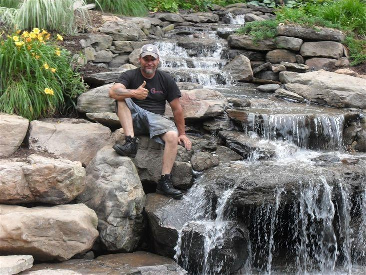 Giant waterfall attached to large koi pond in vienna va for Tiered pond waterfall