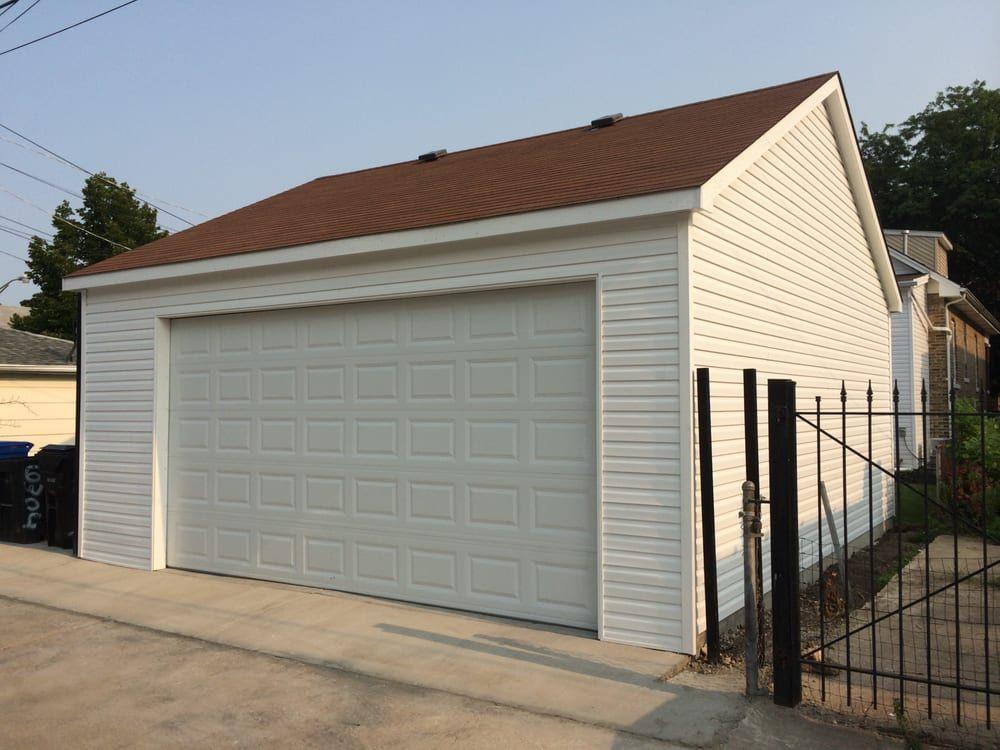 Garage mart 10 foto servizi per porte di garage for 2 piedi quadrati per garage