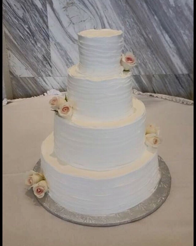 A Four Tier Vanilla And Chocolate Wedding Cake Filled With - Fudge Wedding Cake