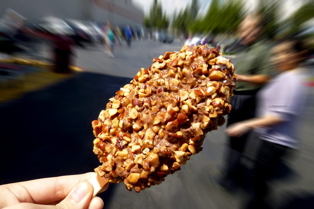 Hand dipped ice cream bar with roasted almonds for Food bar hands