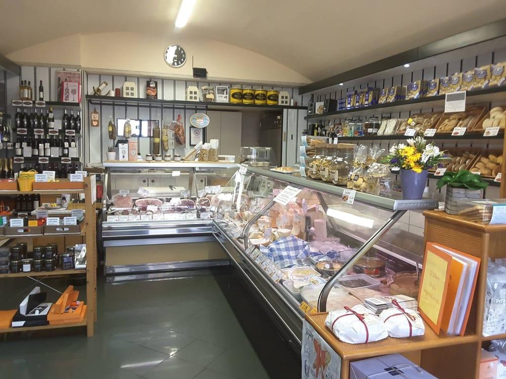 Negozio di alimentari salumi e formaggi gastronomia for Arredamento per salumeria