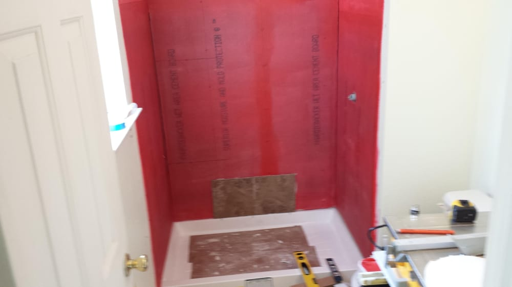 After demo, the hardi backer board was installed, and the walls were ...