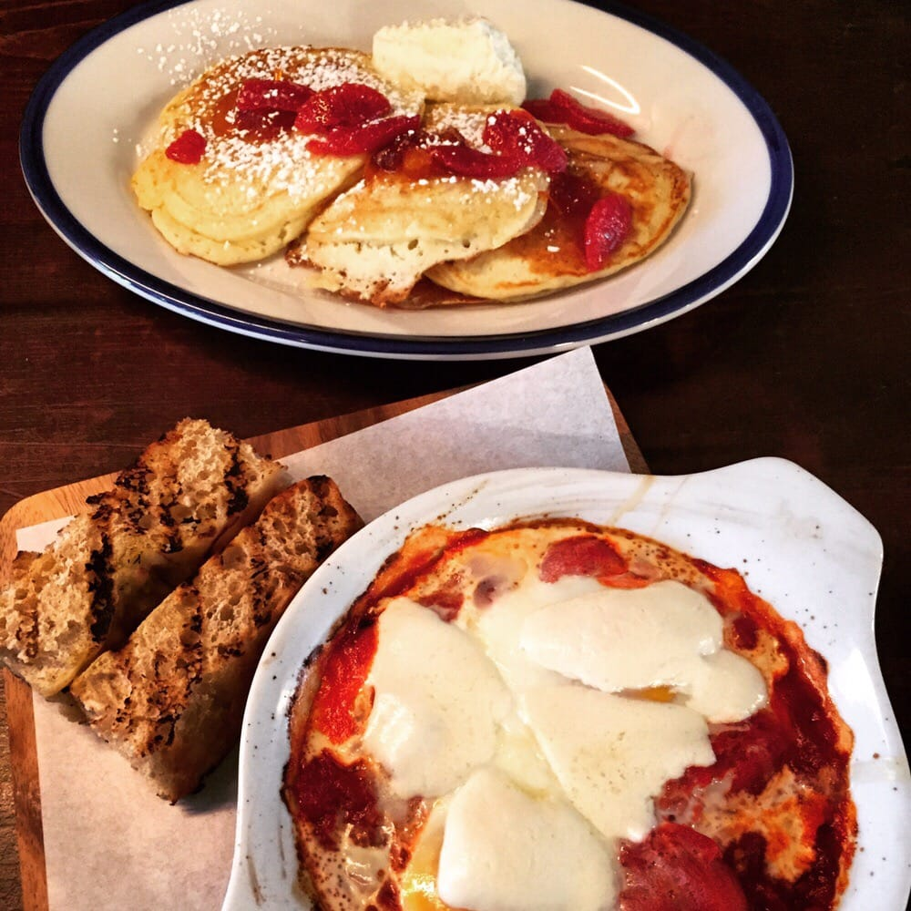Photo of Le Fanfare - Brooklyn, NY, United States. Ricotta pancakes and baked eggs with marinara sauce and mozarella cheese