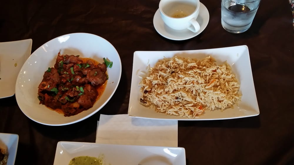 Goat karhai with an extra side of rice yelp for Afghan cuisine houston