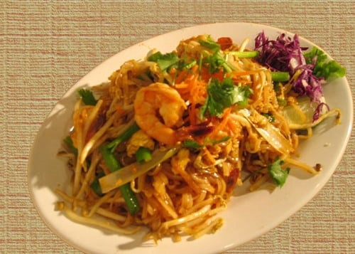 Pad thai noodles the typical thai fried noodles with eggs for Antique thai cuisine