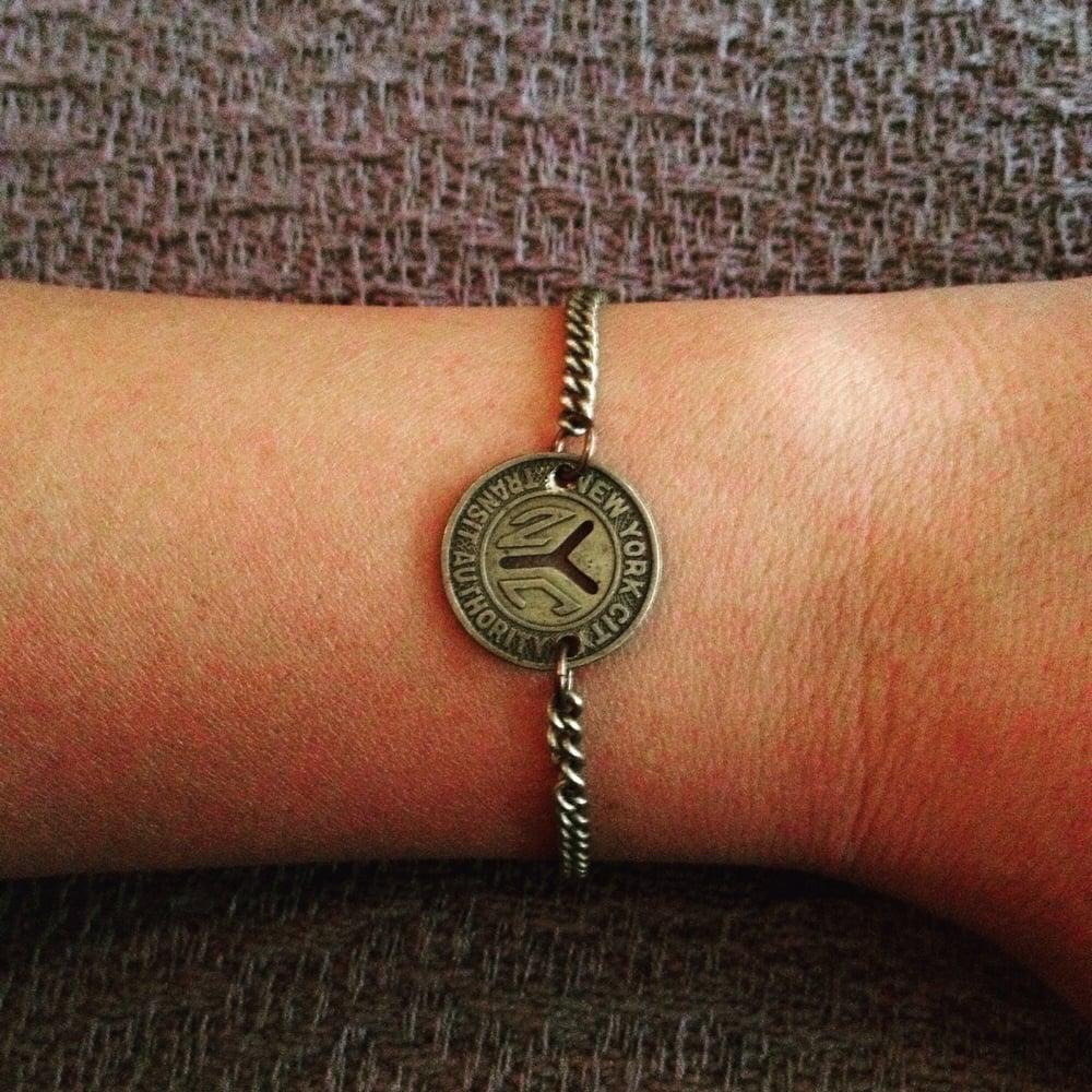 Bracelet by Byrdie jewelry  Vintage NYC subway token  - Yelp