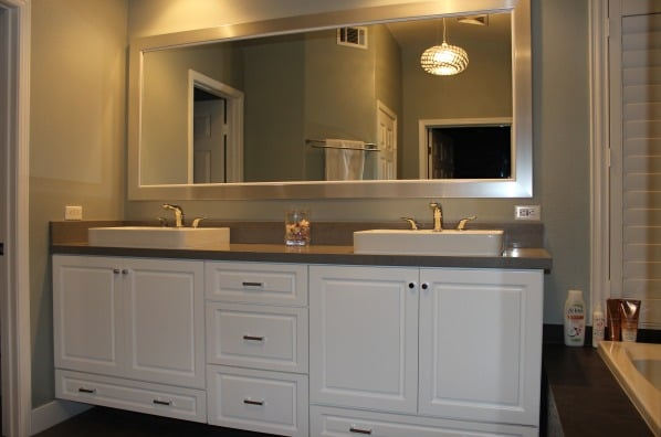 double sink vanity whits cabinets pendents lighting big white frame