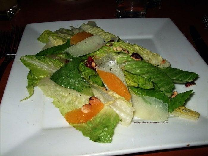 Romaine lettuce salad with mandarin orange wedges, thin ...