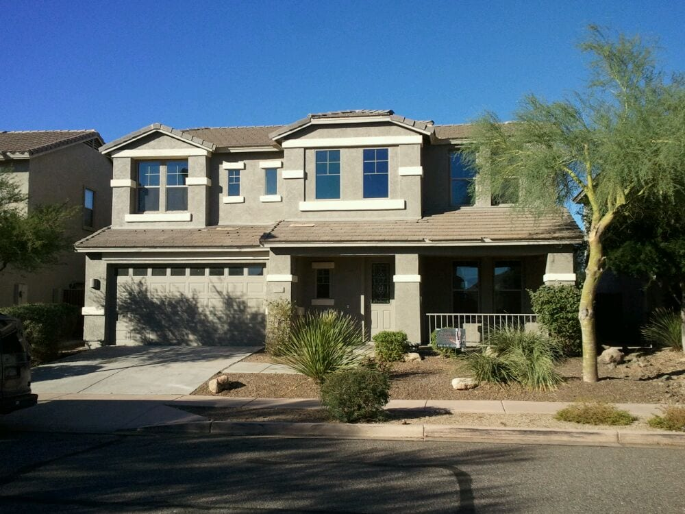 Dunn Edwards Almond for pop out color and Bison Beige for the stucco. - Yelp