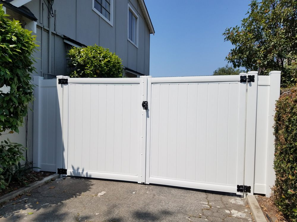 Metal frame double gate wrapped with vinyl - Yelp
