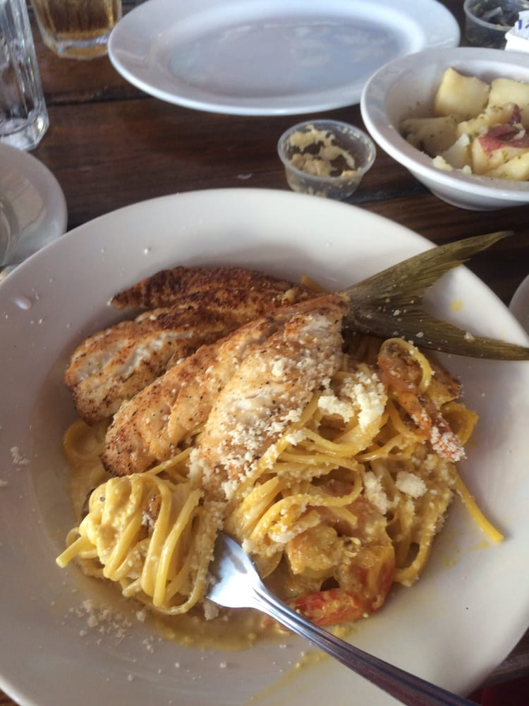Butterfly snapper over yellow aji pasta delicious yelp for Fish market miami