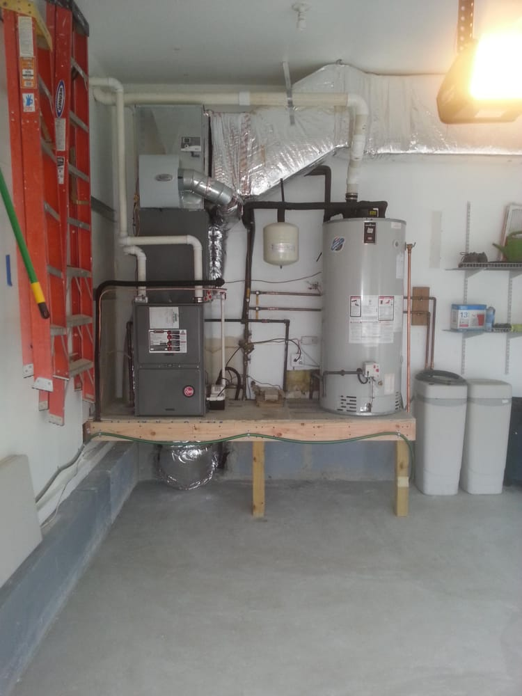 Wood Platform With Concrete Top To Raise Hot Water Heater