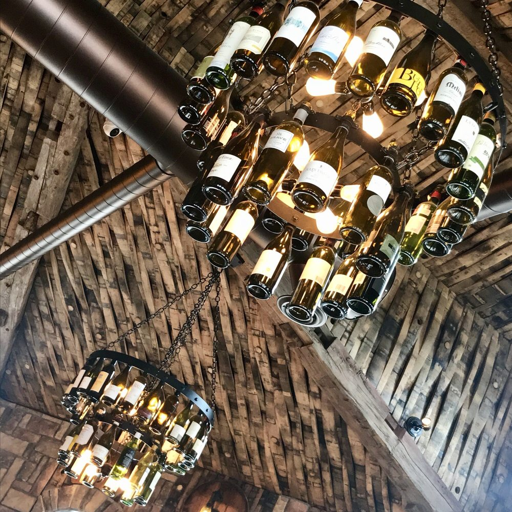 Cute chandeliers out of wine and ceiling from oak wine barrels in photo of buon gusto bistro brighton mi united states cute chandeliers out aloadofball Choice Image