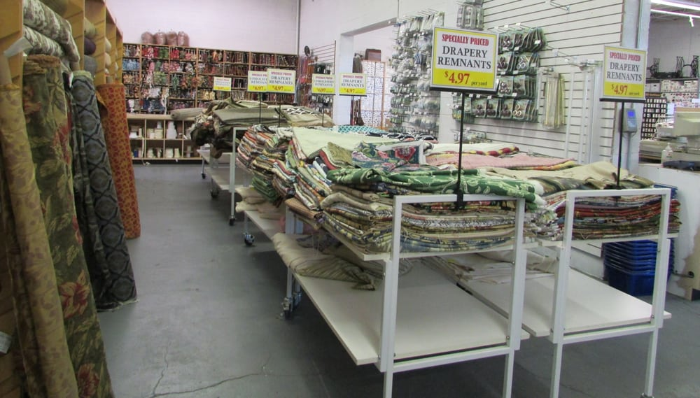 Photo of G Street Fabrics - Rockville, MD, United States. Truckloads of Special Priced Remnant Tables Upholstery-6.97 yd and Decorating-Drapery-4.97 yd in the Home Decorating Dept