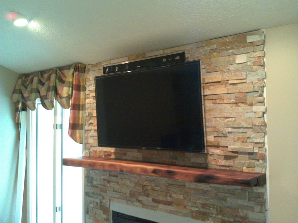 another tv mounted over a fireplace with a soundbar and concealed wiring yelp. Black Bedroom Furniture Sets. Home Design Ideas