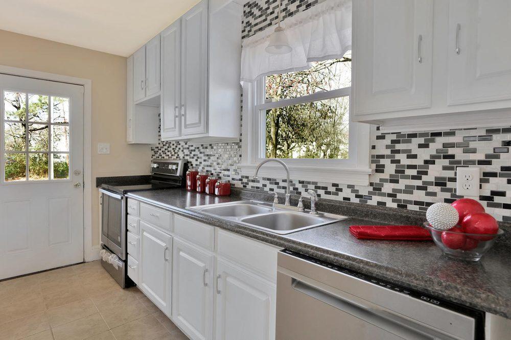 Kitchen remodel, includes new floors, backsplash, cabinets ...