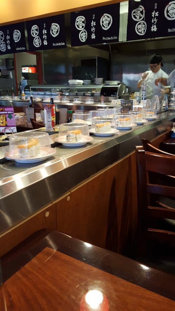 Sushi Rotating Through The Conveyer Belt Constantly