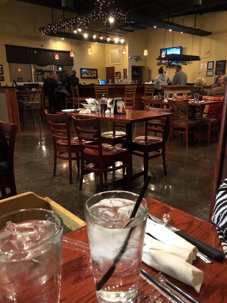 Mostly empty restaurant with messy table yelp