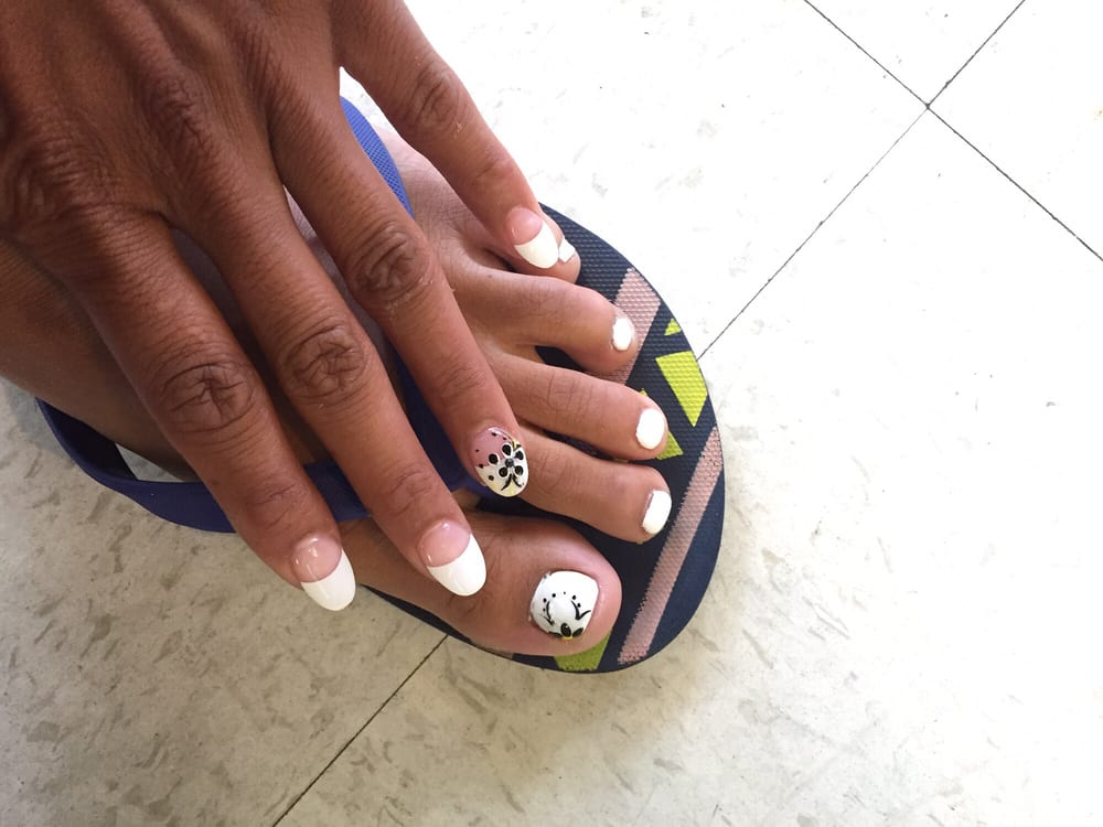 Toes: White gel polish with a flower. Hand: Oval shape French tip ...