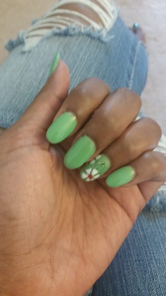 Cute green no chip polish with flower design - Yelp