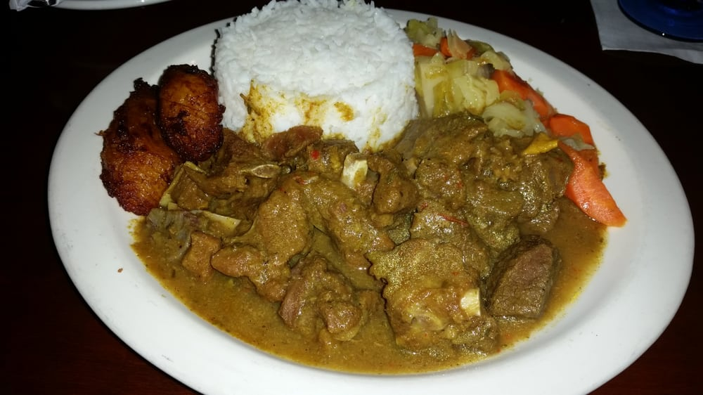 curried goat white rice plantains  steamed cabbage with