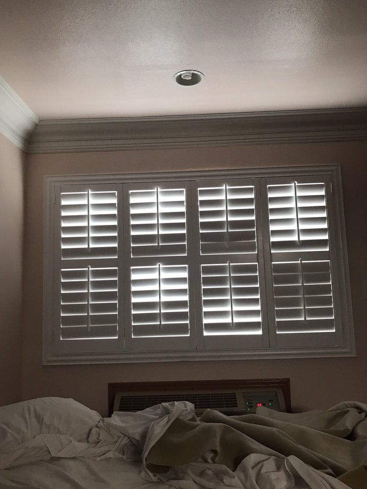 Plantation shutters Those are expensive made the room look