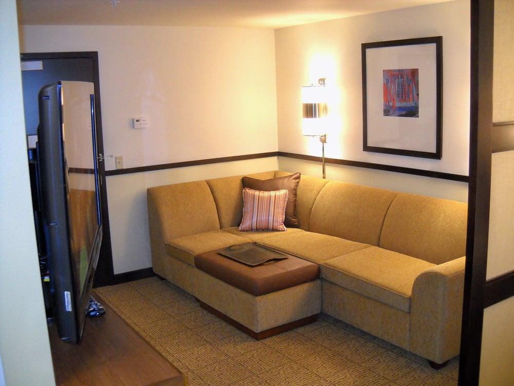Every room has a Cozy Corner Sectional Sofa Sleeper. - Yelp