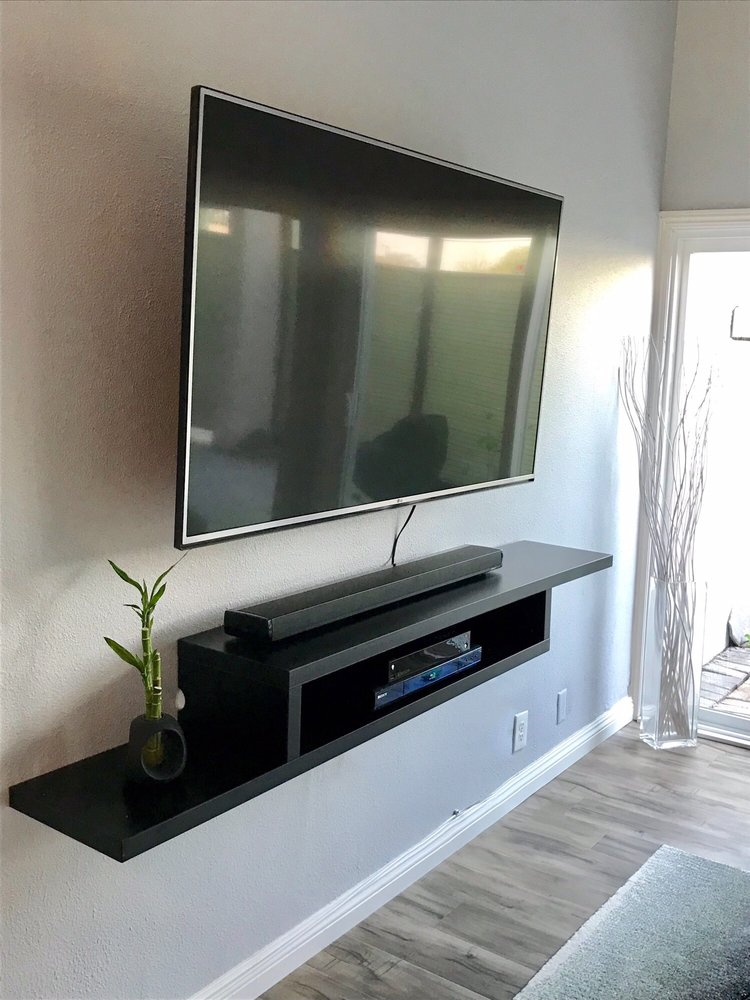 Floating wall mounted tv console nice and level and sturdy