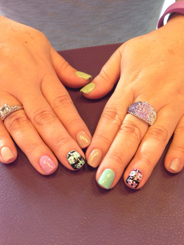 Gelish with different colors pretty designs done by for A perfect ten salon