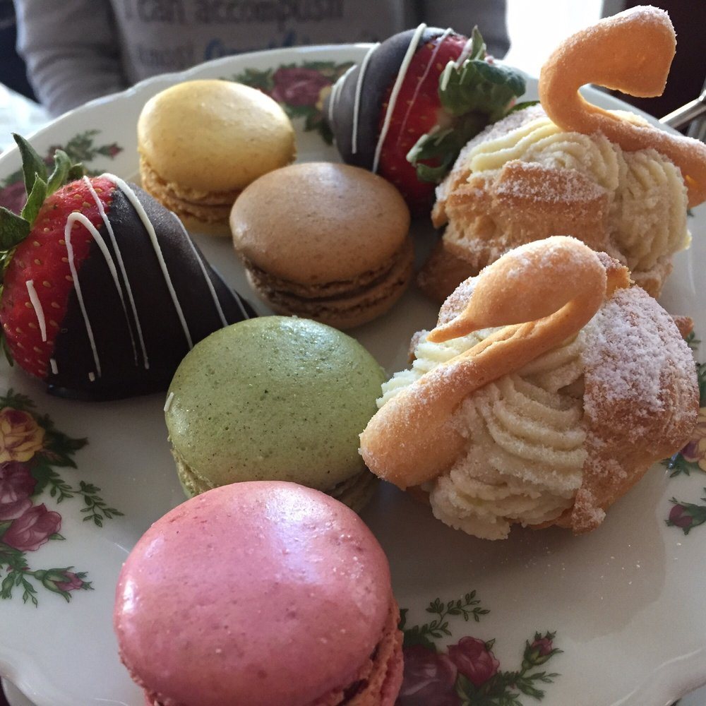 Macaroons, chocolate covered strawberries, and Carmel apple swans ...