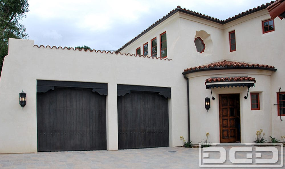 Custom Ipe Garage Door With Asymmetrical Windows With Tinted Glass