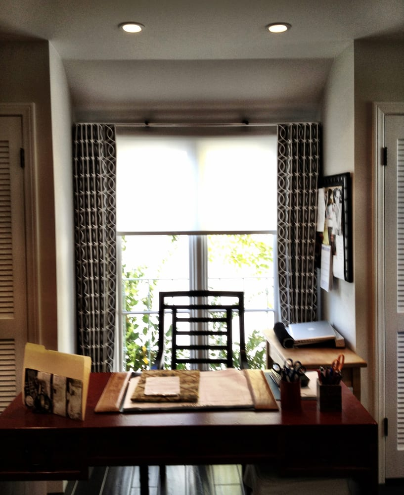 Updating A Traditional Home Office With A Solar Shade And Decorative Draperies To Warm The Room