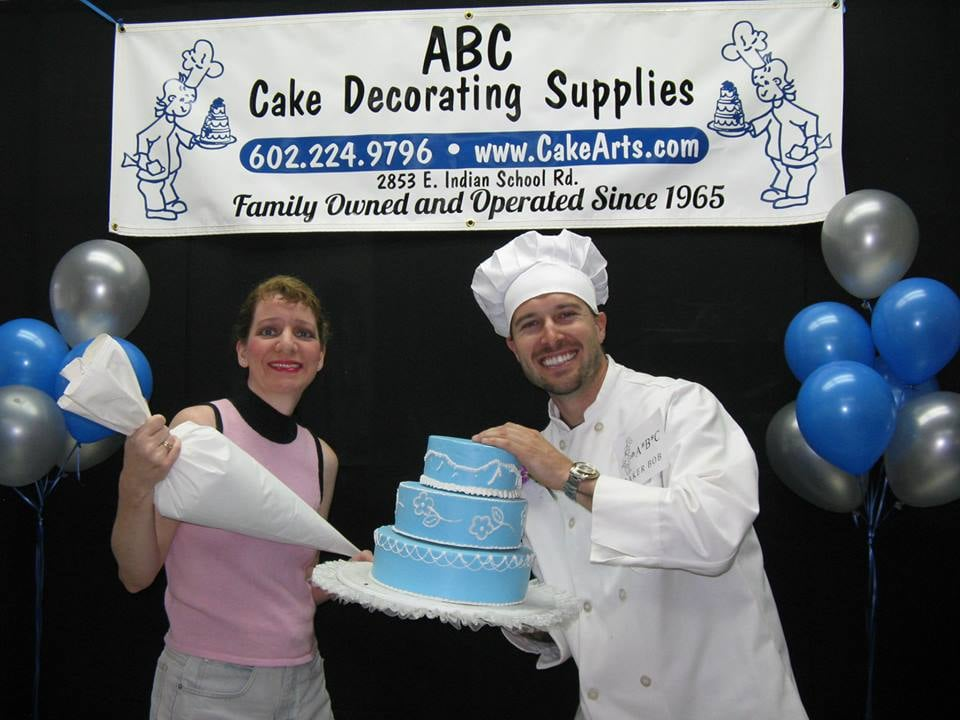 Me baker bob with faux cake props yelp for Abc cake decoration