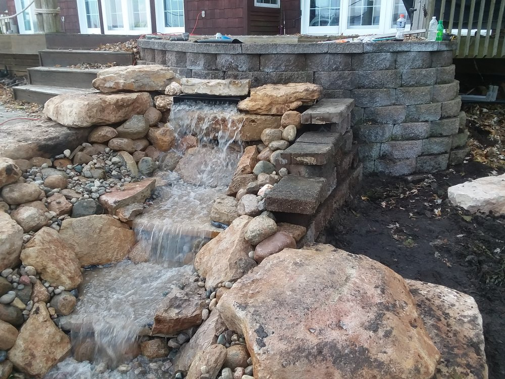 Water fall built in front of a retaining wall. - Yelp on