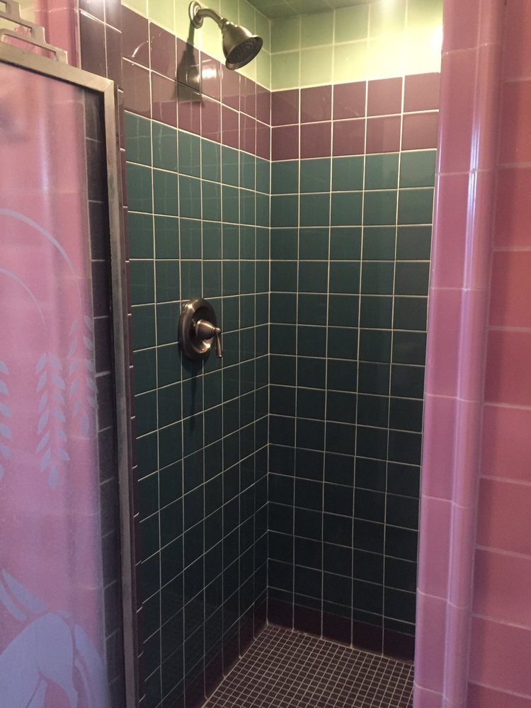 New shower stall tile while keeping the original tile framing the ...